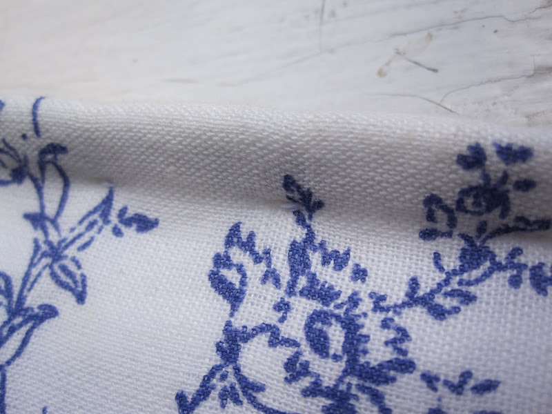 Stab stitching showing on the front of the garment