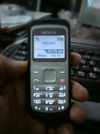Nokia 1203 on hands