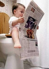 kid-sitting-in-toilet-426x600