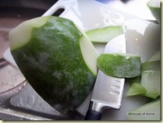 slicing skin off winter melon