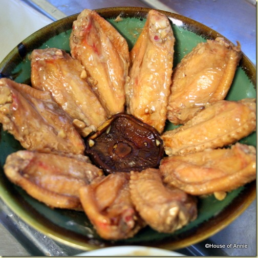 Arranging Chicken Wings in Bowl