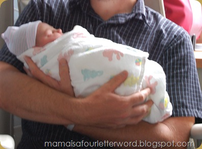daddy holding baby