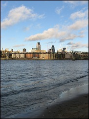 The City of London skyline, from the South Bank at low tide.