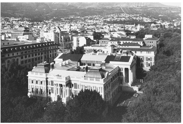 Cape Town, South Africa. The coastal city of Cape Town, founded by the Dutch in 1652, is now home to South Africa's legislature. The parliament building appears in the foreground of this photograph.