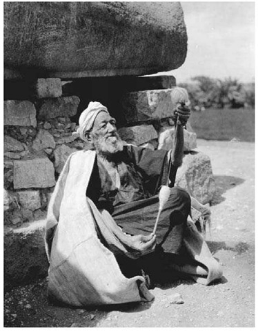 Spinning Cotton, 1920s. This elderly Egyptian man spins cotton by hand using a simple, centuries-old spinning technique.
