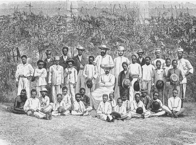Missionaries in Benin. A group of European Christian missionaries pose with students in Porto-Novo, Benin, in this illustration from the History of the Catholic Missions (1882).