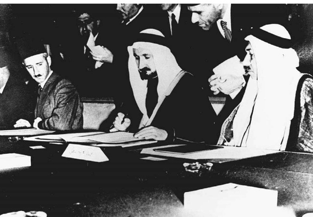The Signing of the Pact of the League of Arab States, March 1945• Saudi Arabian sheikh Youssek Yassin (center), the acting minister for foreign affairs, signs the League of Arab States charter in Cairo, Egypt.