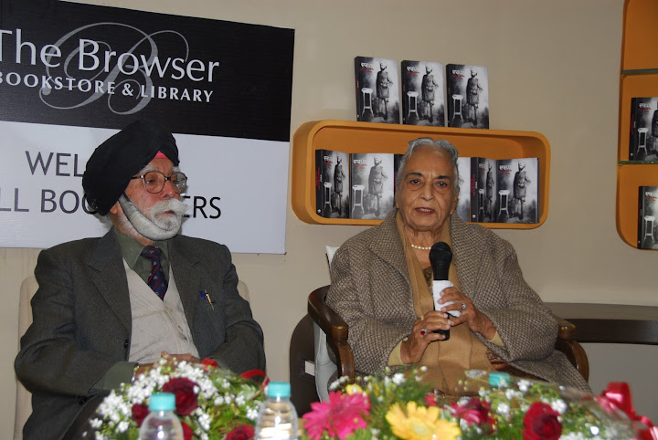 Brig Gobindar Singh looks as Mrs Inderjit Kaur addresses the audience