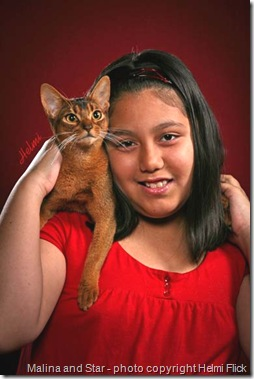 Keira's daughter and Abyssinian cat