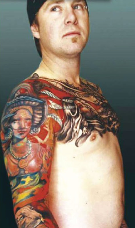 extreme tattoo on male body