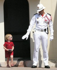 A Monegask Guard stops a young girl