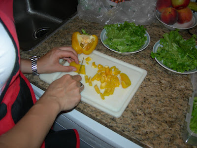 Kate chopping a yellow pepper