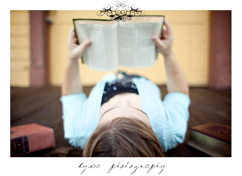 Emi reading an old book for her senior portraits at Colfax California