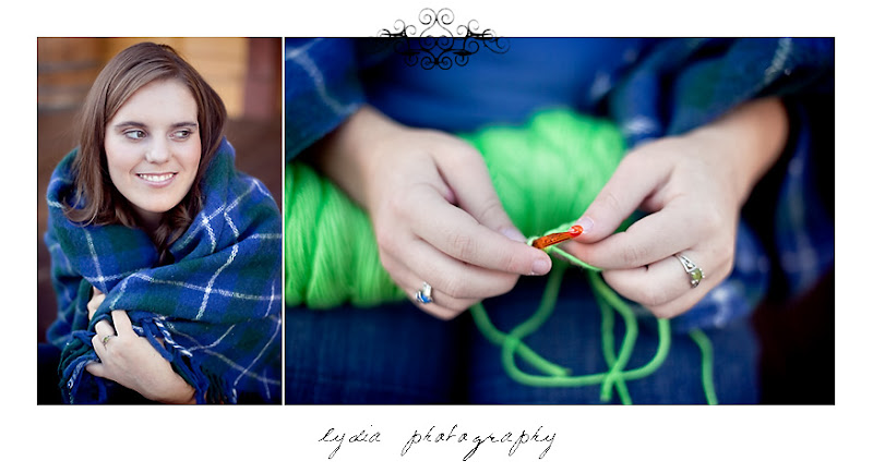 Emi wrapped in her grandpa's blanket and crocheting during her senior portraits at Colfax California