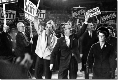 Tommy and Irma Douglas. Photo taken by Frank Lennon/Toronto Star Nov. 4, 1965. Also published 19691018 with caption: Tommy Douglas makes a triumphant entrance into a Maple Leaf Gardens rally during his 1965 rally. the New Democratic party leader will be 65 Monday.