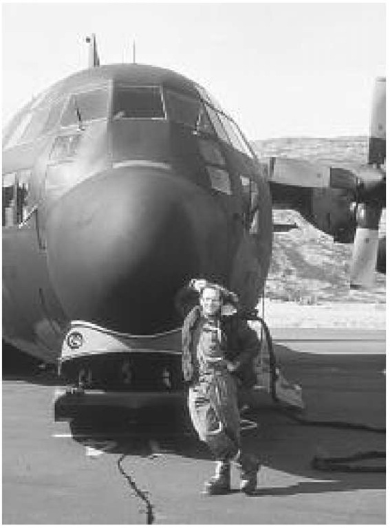 Richard B. Alley, in full field gear, standing in front of a ski-equipped LC-130 Hercules aircraft of the 109th U.S. Air National Guard in Sondrestrom, Greenland
