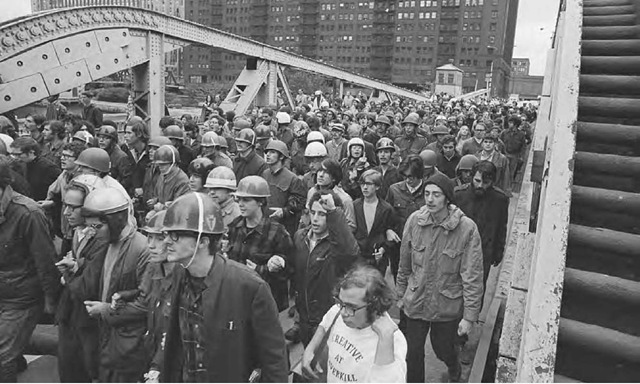 Members of the Weathermen march across the Chicago River bridge to the downtown Loop, October 11, 1969. Militant radicals went on a window smashing spree and battled police before the eyes of startled shoppers. At least thirty-five people were arrested and the Illinois National Guard was called out.