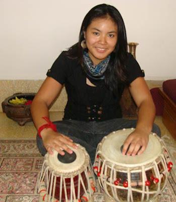 Victoria Sisouphone playing Tabla