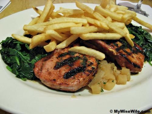 Grilled pork with apple sauce, vegetables and fries
