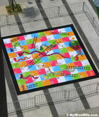 Giant Snake and Ladder Game at urban square