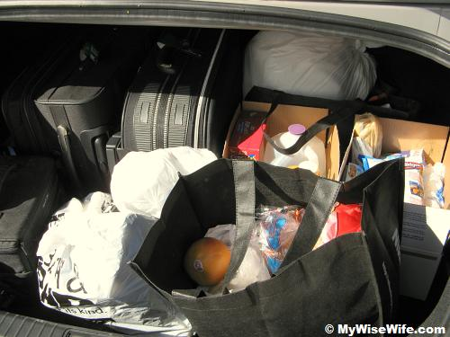 The car boot is full with 4 days' supplies and resources