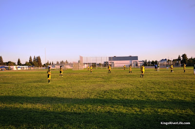 Reedley Athletics play soccer