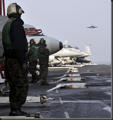 Super Hornet fighter aircraft preparing to land