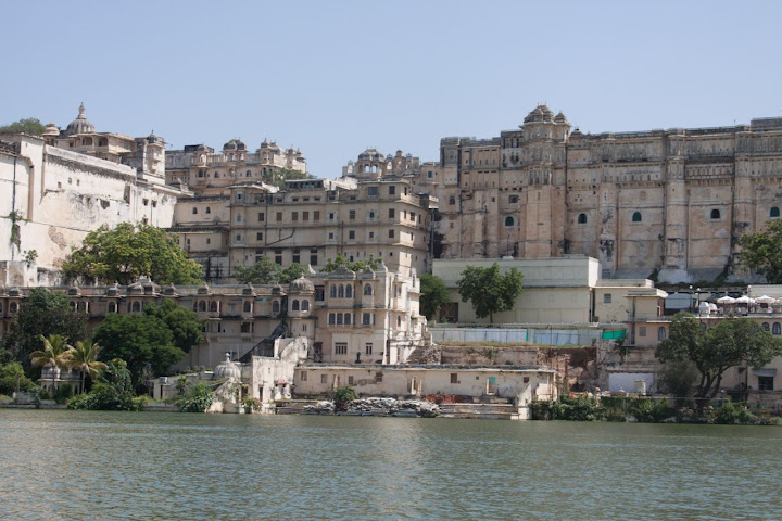 View of the Udaipur City Palace, as seen from a boat on the Lake Pichola in Udaipur