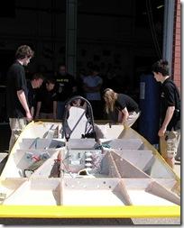 Kenwood Hoben, AJ Owman, Josh Allen, Madeline McAuley, and Mitch Panek prepare Sunseeker for unveiling