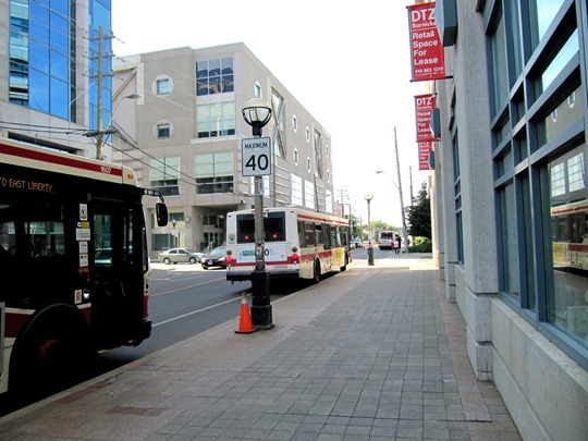 Three Toronto TTC buses blocking bike lane
