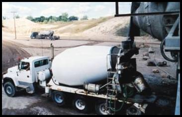 Fig. 4. Central mixing in a stationary mixer of the tilting drum type with delivery by a truck mixer operating at agitating speed.