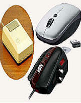 Metamorphosis: (Clockwise from left) The Apple Macintosh one-button mouse from 1984, Logitech's V550 cordless notebook laser mouse and Microsoft's 'Sidewinder' mouse for gamers.