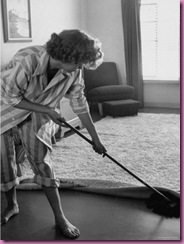 woman cleaning in pajamas