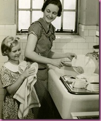 child and mother washing dishes