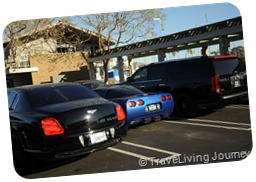 Typical CA PArking lot - Bently Corvette and Cadillac