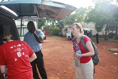 Suzy, Kiganda and Suzanne packing the car for a day in Kampala.