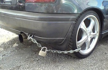 Car secured with a chain and padlock