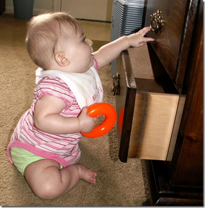 Elaine 6 months playing in drawer