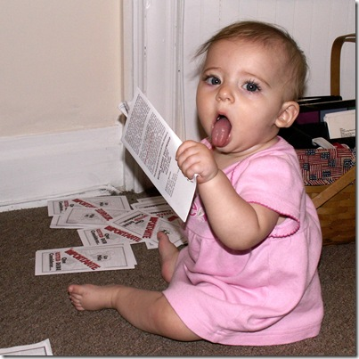 Elaine 7 months eating Spanish tracts