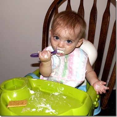 Elaine 8 months messy yogurt eat