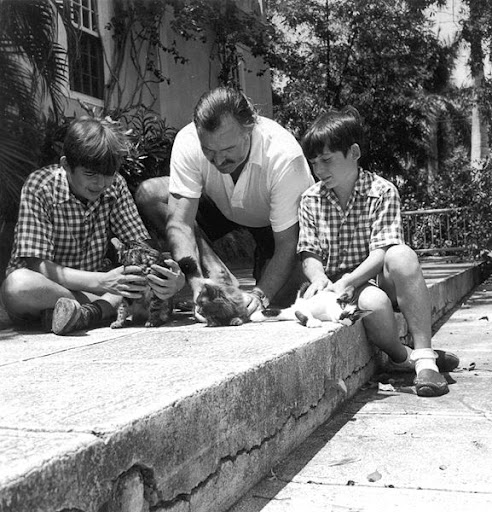 earnest hemingway and children playing with kittens