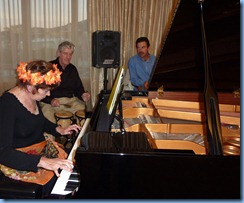 Carole Littlejohn playing grand piano with accompaniment by Ian Jackson on drums
