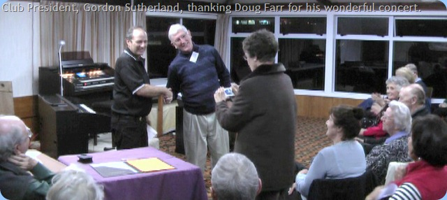 Club President, Gordon Sutherland, thanking Doug Farr for a great concert. Whilst Club Secretary, tries to take a photo with an unfamiliar camera. This photo is a video frame grab and so not as sharply in focus as desirable.