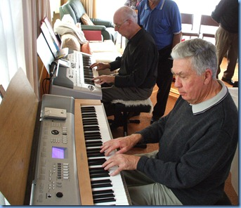 A rare gem! Peter Brophy, Club Musical Entertainments Bookings Manager, playing the Korg Pa1X with Jim Nicholson, Club Treasurer, accompanying on piano