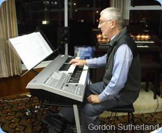 Gordon Sutherland trying out Taka Iida's Yamaha D-Deck keyboard