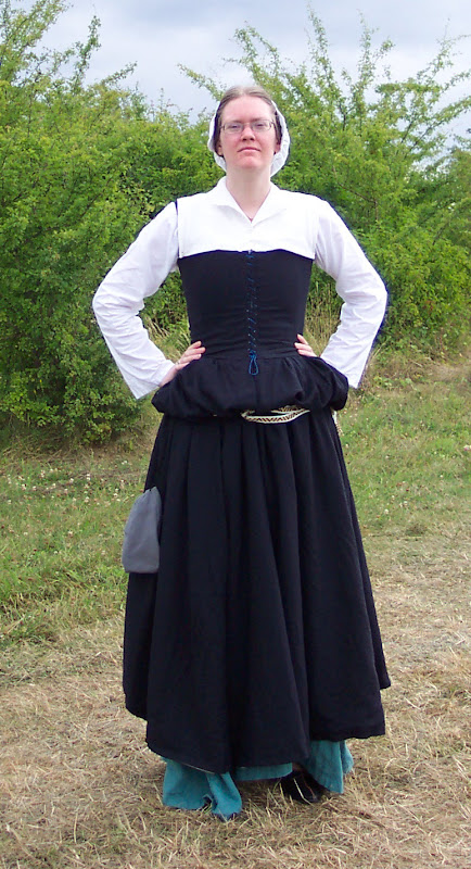 With the skirt blouse over a belt