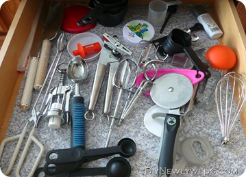 unorganized_utensil_drawer