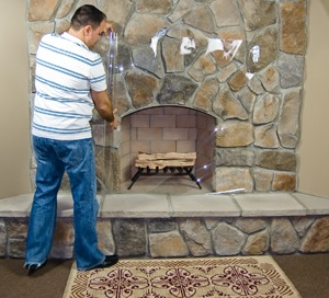 [Unrolling the plastic over the fireplace[2].jpg]