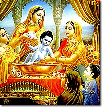 Women tending to baby Krishna