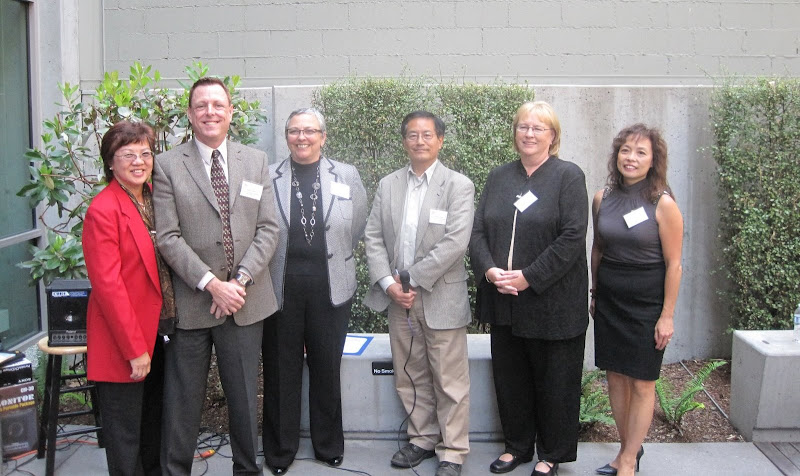 Representatives from San Francisco credit unions (from left to right): Lily Lo, Manager & CEO NECFCU; Barry Kane, SVP Patelco CU; Diane Dykstra, CEO SF Fire CU; Michael Chan, Board Chairman NECFCU; Lynn Athens, CEO Spectrum CU; and XX, title, San Francisco Municipal Employees CU.